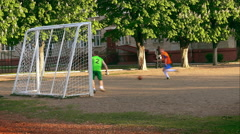 Amateurs Play Football on Playground Stock Footage