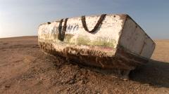 Rotten fishing boat in desert, Peru Stock Footage