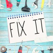 Stock Illustration of Fix it against tools and notepad on wooden background