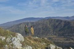 Two scientists standing on top of a hill Stock Photos