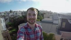 Happy Tourist Takes A Selfie On A Rooftop In San Francisco (4K) Stock Footage