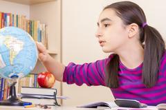Schoolgirl learns geography Stock Photos