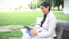 Businesswoman listening to music on tablet Stock Footage