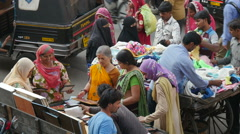 Hindu and Muslim women shopping at roadside stall in Jaipur, India Stock Footage