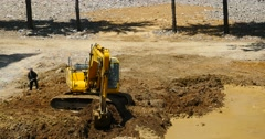 4k closeup excavator working & dumper truck on construction site,china. Stock Footage