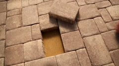 Brick tile being placed - stock footage