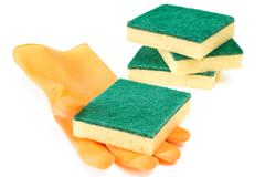 Scouring sponges with rubber glove - stock photo