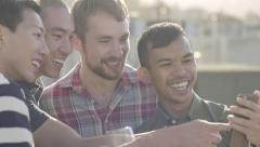 Group Of Friends Enjoying Happy Hour On A Rooftop, They Take A Photo Together Stock Footage