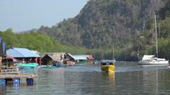 Boats carry tourists to Paksu fish farm, Kilim Karst Geoforest park, Langkawi Stock Footage