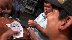Latinos playing Cards on street, South America Stock Footage