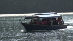 Boats carry tourists to Kilim Karst Geoforest park, Langkawi, Malaysia Stock Footage