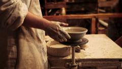 Stock Video Footage of Potter hands sculpturing ceramic bowl on potter's wheel