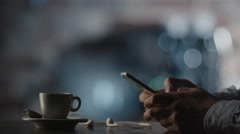 Using Mobile Phone in Coffee Shop Stock Footage