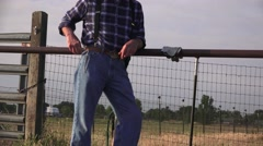 Rancher at the hitching rail checks time Stock Footage
