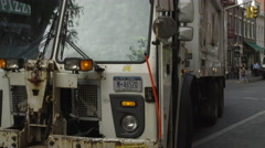 garbage truck driving; sanitation, with Empire State Building background 4K NYC - stock footage