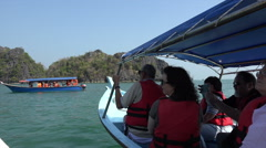 Tourists visit Kilim Karst Geoforest park by tour boat, Langkawi, Malaysia Stock Footage