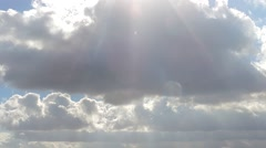 Clouds passing by with sunrays, fast moving, time lapse Stock Footage