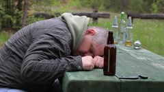 Drunk men with bottle of alcohol at outdoor Stock Footage