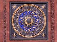 Old public zodiac clock on brick wall - stock photo