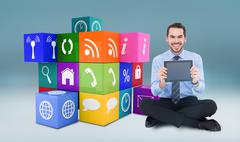 Stock Illustration of Composite image of smiling businessman showing his digital tablet