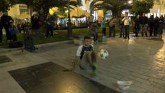 Fantastic ball performance on street at night Stock Footage