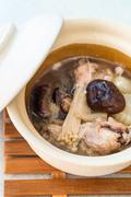Chicken soup with chinese herbs and mushrooms - stock photo