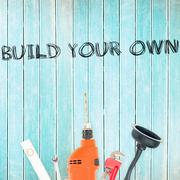 Stock Illustration of Build your own against tools on wooden background