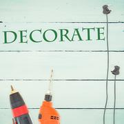Stock Illustration of Decorate  against tools on wooden background