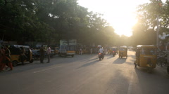 Late afternoon traffic and pedestrians on busy Chennai street Stock Footage