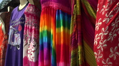 Summer dresses hang in shop on island of Langkawi, Malaysia Stock Footage