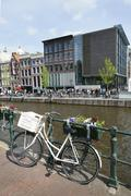 bicycle on prinsengracht opposite anne frank house - stock photo