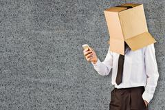 Composite image of anonymous businessman with his smartphone - stock photo