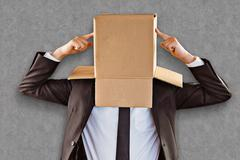 Composite image of anonymous businessman pointing to box - stock photo