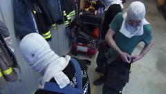 Firemen Dress quickly Stock Footage