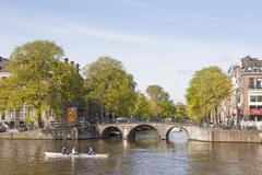 Amstel and herengracht on a sunny spring morning in amsterdam Stock Photos