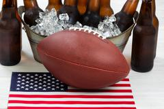 Fourth of July celebration with football and ice cold beer - stock photo