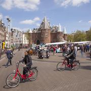 Tourists ride rental bikes on nieuwmarkt in amsterdam Stock Photos