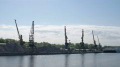 Port cranes against sky Stock Footage