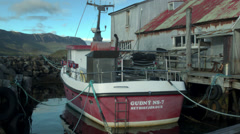 Boat in Harbor in SEYDISFJORDUR, ICELAND  Stock Footage