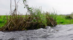 Water stream in a river on cloudy day Stock Footage