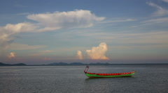 Bright colored wooden Cambodian boat on lake like sea with sky perspective Stock Footage