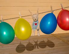 Colorfull balloons pinned on a washing line Stock Photos