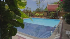 Thai style swimming pool in Phuket Stock Footage
