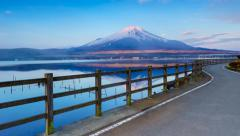 Stock Video Footage of 4K Timelapse of Moon set and Sun rise over Mt. Fuji at Yamanaka lake,  Japan