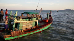 Cambodian fishing vessel departs at dusk. Stock Footage