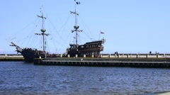 Corsair ship leaving the seaport of Ustka, Poland - stock footage