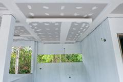 Unfinished house ceiling in the construction site Stock Photos