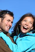 Happy young couple active outdoors Smiling portrait - stock photo