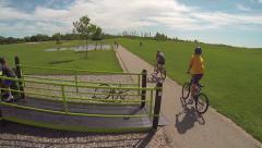 Kids biking on path aerial Stock Footage