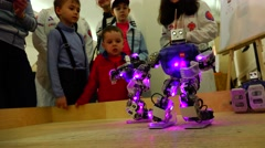 New technologies. Robot.  AI. Children watching the dancing robots. Stock Footage